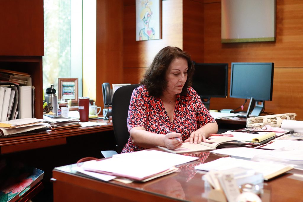 Vice President Rosanne Palacios reviews work in her office.