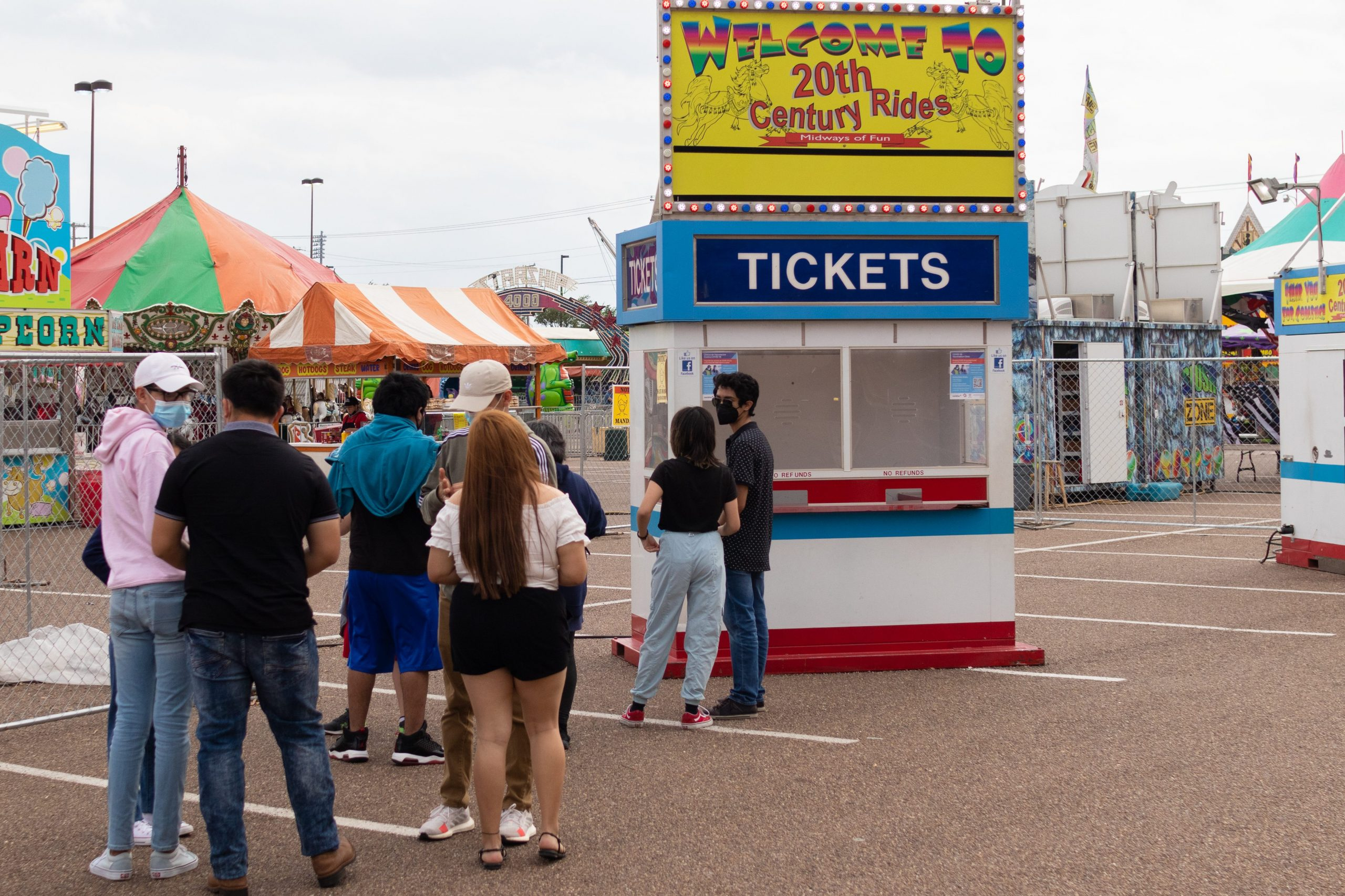Carnivalgoers wait in line to purchase tickets