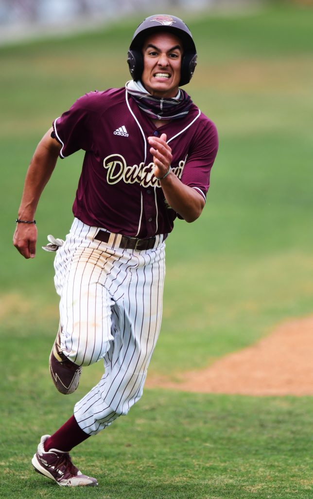 TAMIU runner heads home to score a run
