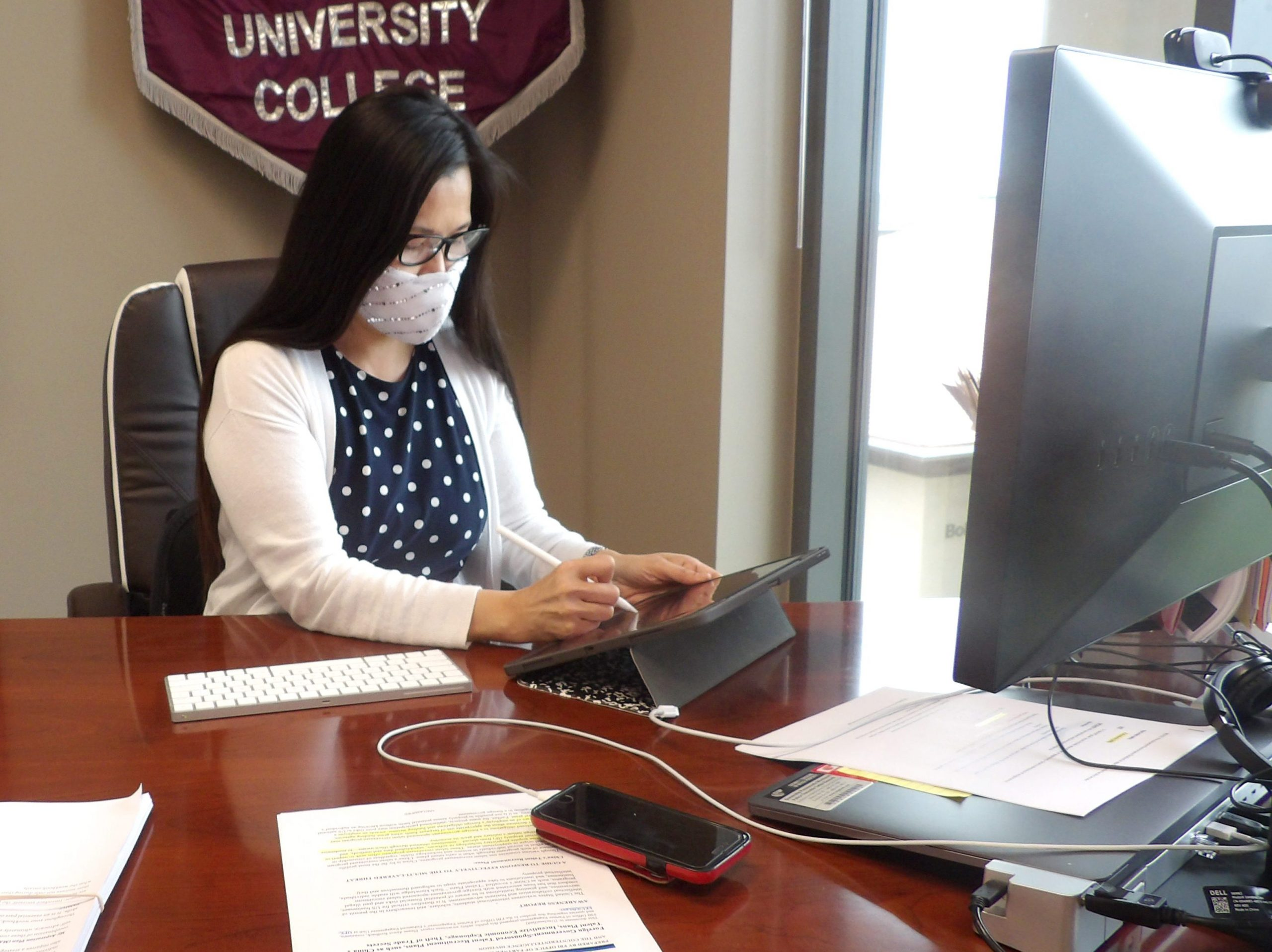 Dean Barbara Hong works in her office.