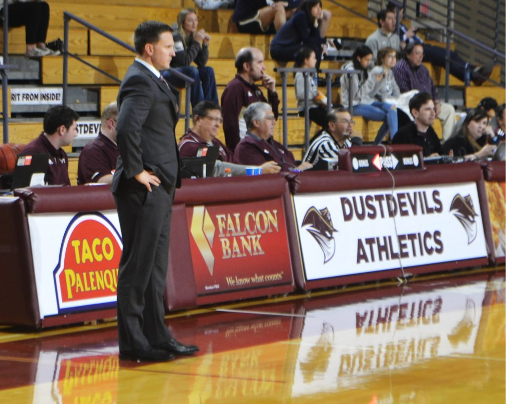 Coach Nate Vogel watches a play in a file photo from 2020