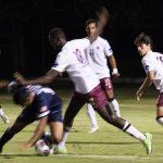 Men win first soccer game of season